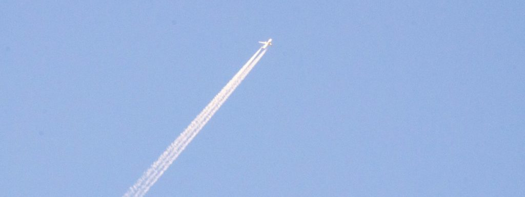 airplane flying over mount parnitha, greece