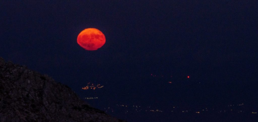 moon rising over athens from mount parnitha