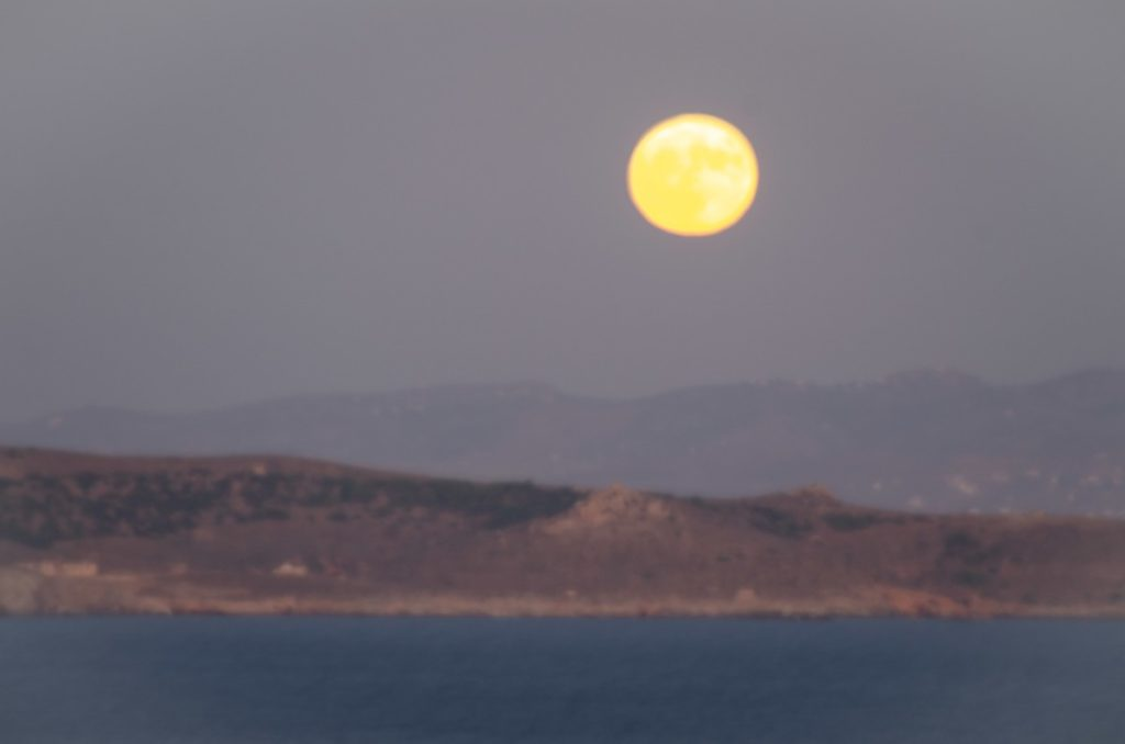 moon rising above makronisos