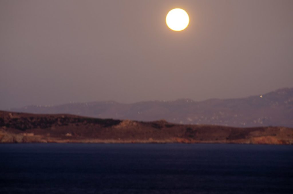 moon rising over makronisos from cape sounion