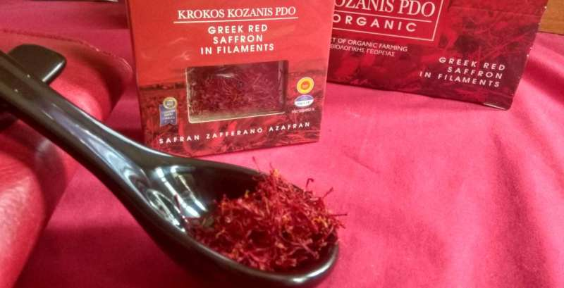 saffron imported from greece in large spoon with krokos kozanis packaging