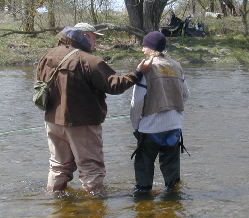 ian colin james teaching colin scott to fly fish on the Grand River