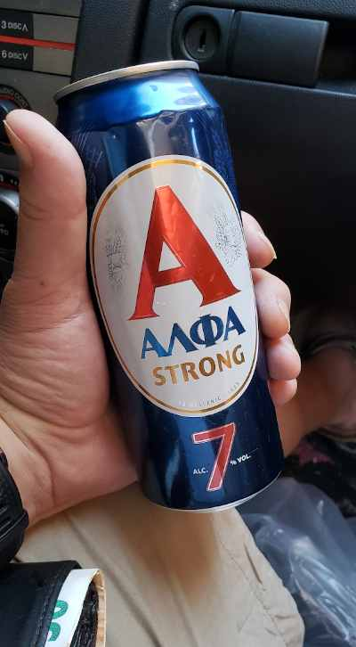 can of alfa strong beer in athens, greece while sitting in car