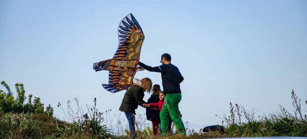 family flying a kite at acrocorinth on clean monday 2020